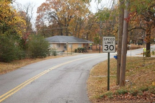 This photo from the National Transportation Safety Board shows a curve in Talley Road in Chattanooga, Tennessee, at the site of the Nov. 22 fatal school bus crash.