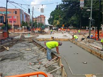 July 10, 2014 - Crews are working to prepare for the installation of the first streetcar switches at the corner of 12th and Race. Courtesy City of Cincinnati