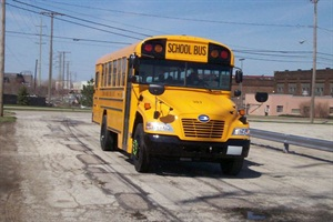 The first of 49 Blue Bird Propane Vision school buses arrives at Cleveland Metropolitan School District's depot.