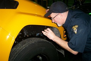 Ohio state inspector Chip Hilling examines one of Cleveland's new propane buses.