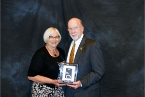 Bruce Dischinger, an owner of Monarch Bus Service, received the Jim DeVeau Award. He is pictured with Donna Dischinger.