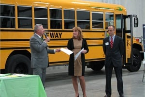 Ron Bast (left), president of GO Riteway, discusses the benefits of propane autogas with Dr. Sara Burmeister, Oak Creek school superintendent, and Frank Carini, school board president, at an open house on Wednesday.