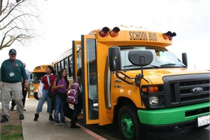 The first of four all-electric SSTe school buses from Trans Tech Bus is in service at Kings Canyon Unified School District in Reedley, Calif. At left is former Director of Transportation John Clements, who helped the district secure the buses.