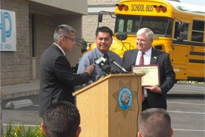 Ricardo Ramos (center) of Student Transportation of America accepts the California Highway Patrol (CHP) Southern California School Bus Driver of the Year award from CHP Commissioner Joe Farrow (left) and Riverside Unified School District Interim Superintendent Mike Fine.