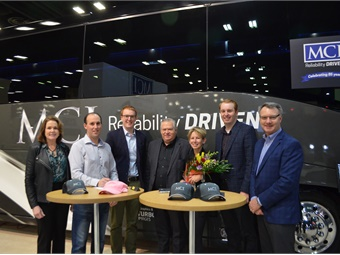MCI's Pat Ziska, (left)Guy Charron, (center) and Patrick Scully (left) join Coach Atlantic's Adam Doiron, Matthew Cassidy, Marsha Doiron and Stephen Cassidy in the MCI booth at UMA Expo.  MCI