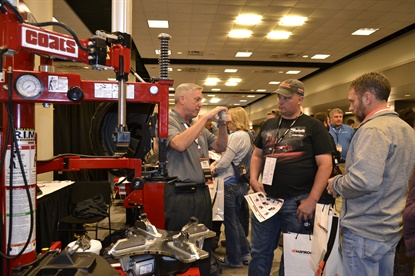 Keith Vinje, district sales manager for Hennessy Industries, talks to Larry Schrock of Schrock Automotive in Thomas, Okla., about the company's Coats line of equipment. Schrock was in the market for heavy-duty equipment.