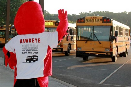 Cobb County's stop-arm safety mascot, Hawkeye, salutes school bus drivers for National