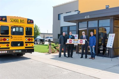 "The Kansas State Department of Education's ""Stop on Red, Kids Ahead"" campaign includes bumper stickers donated by Collins Bus Corp. Photo courtesy Collins Bus Corp."