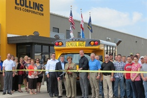 Collins employees and NSTA board members help launch the first NEXBUS. In front of bus, from left, are NSTA's Todd Monteferrario (First Student), Tim Flood (The Trans Group) and Magda Dimmendaal (Dousman Transport) and Collins' Kent Tyler and John Doswell.