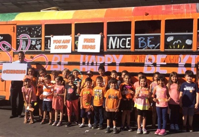 Students saw the Kindness Bus pull up to their campuses and received stickers and bookmarks with anti-bullying messages.