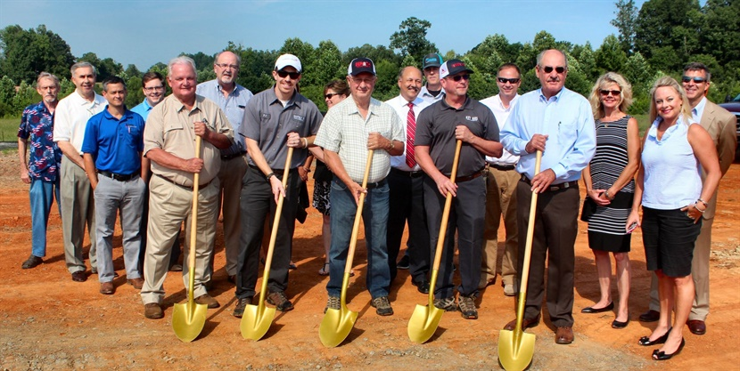 Holding shovels (from left) are Tom Smitherman, realtor; TJ Beroth, store manager,Tom Beroth, owner; T. Beroth, owner; Bill Junker, land developer/seller. On far right is Mayor Will Marklin andTerry Bralley, president of the Davie County Economic Development Commission is between Tom Smitherman and TJ Beroth.They are surrounded by Mocksville Chamber of Commerce representatives and members.