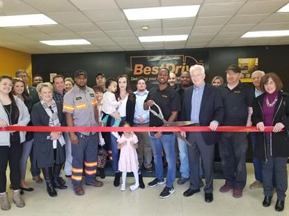 BestDrive employees, the local chamber of commerce, and other community members attended the ribbon cutting event. Operations Manager Erick Oyemaja cut the ceremonial ribbon.