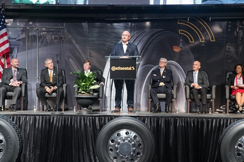 Michael Egner, plant manager, speaks during the grand opening event at Continental's truck tire plant. Also on stage, from left, Paul Williams, Continental executive vice president of commercial tires in the Americas; Philip Gunn, speaker of the Mississippi House of Representatives; Tate Reeves, lieutenant governor; Phil Bryant, governor; Christian Koetz, Continental executive board member; and Peggy Calhoun, president of Hinds County Board of Supervisors.