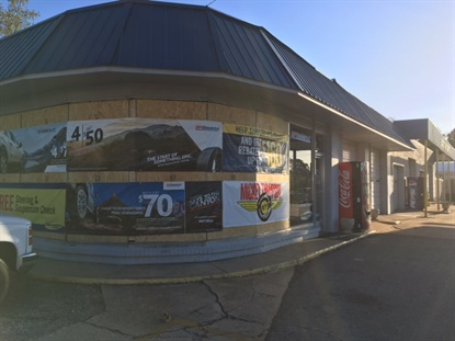 Plywood, and tire banners, take the place of windows at the Conway, S.C. Black's Tire store.