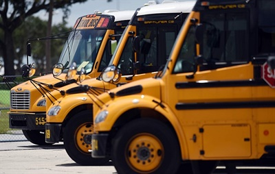 Cook-Illinois Corp. has quadrupled the number of propane buses in its fleet with the addition of 50 Thomas Built Saf-T-Liner C2 buses. Shown here are some of the propane buses currently in the contractor's fleet.