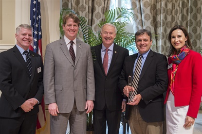 Cooper is celebrating a trade award, from left to right, with Arkansas District Export Council Chairman Bill Burgess, Cooper Texarkana Distribution Manager Curtis Schneekloth, Arkansas Gov. Asa Hutchinson, Cooper Texarkana Plant Manager Scott Cole and Export CouncilVice-Chair Lenka Horakova.