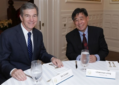 Triangle Tire Chairman Ding Yuhua (right) and North Carolina Gov. Roy Cooper announced the decision to build Triangle's first plant outside of China in North Carolina at an event held at the governor's mansion on December 19.