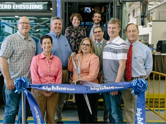 GILLIG's President/CEO Derek Maunus and Cummin's Julie Furber, joined BBB Director of Transit Services Ed King (background) and other city and local officials at a ribbon-cutting event.