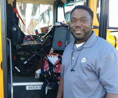 Curtis Jenkins, a school bus driver in Texas, saved money from his paychecks to buy Christmas gifts for every student he drives. Photo courtesy Annette Guerra-Renaud