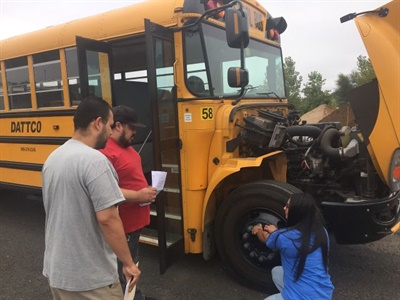 As part of DATTCO's new security training, drivers are instructed on what to do if they find something suspicious during pre-trip inspections. Shown here is a routine training on pre-trip inspections.