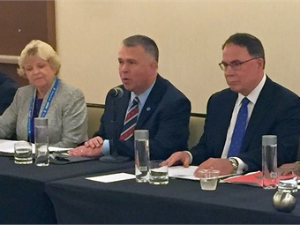 The new APTA chair is Doran J. Barnes, executive director, Foothill Transit, West Covina, Calif (shown center).