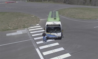 """Virginia Tech Transportation Institute is using an inflatable vehicle target for forward-collision testing and a remote-controlled """"pedestrian"""" mannequin that can simulate standing, walking, and running in front of the bus. VTTI/Stephen Tanner"""