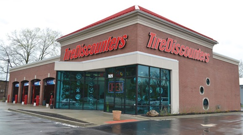 Tire Discounters rebuilt its first store, which features blue-tinted showroom windows. Additional stores will follow the same design; depending on the lot, they will have between six and 14 bays.