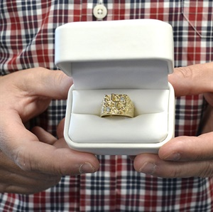 """Pee Wee Rhodes wanted to do something special for longtime employees. In 1988 he gave the first gold ring to James """"Peto"""" Williams for his 25 years of service. Williams was one of Pee Wee's first car wash employees."""