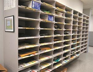 Even with all the high-tech advancements of business, there's still a place for low-tech systems that work. This bank of mailboxes is used to sort everything from paperwork to printer ink that needs to go to each store.