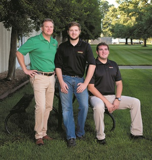 Mark's sons Zach, center, and Sam, right, are both learning the ropes of the business when not away at college.