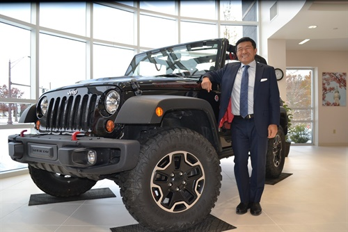 """Nexen is fully committed to the U.S. market,"" says Vice Chairman and Global CEO Travis Kang, who is pictured alongside a Jeep fitted with Roadian MTX replacement tires in the lobby of the company's new tire technology center in Richfield, Ohio."