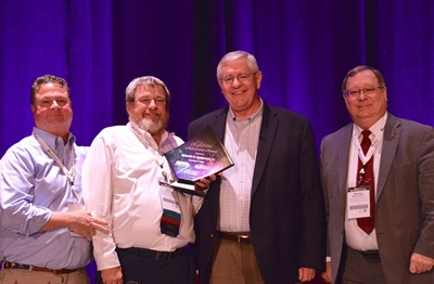 Ken Hedgecock (second from right),current vice president of sales, marketing, and service for Thomas Built Buses, washonored with NAPT's Lifetime Achievement Award.