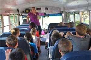 Driver Dawn Lemaster helps her passengers with reading during non-travel time as part of Lake Orion Community Schools' BusSTAR program.