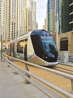 Power is supplied to the tram via segmented street-level rail embedded between the running rails on the axis of the track. When the tram leaves the section, the segment is de-engergized and therefore safe for cars, bikes and pedestrians to cross.