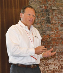 """Stu Crum tells employees Bridgestone isn't in the tire business. """"We're in the people business. We mean that seriously. It's all about people. It's all about service."""""""