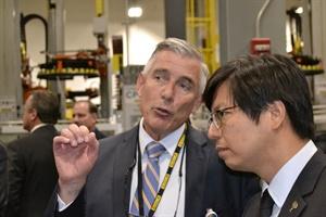 Walmart CEO and President Greg Foran, left, talks with Giti Tire (USA) Chairman Enki Tan during a tour of the new Giti plant in South Carolina.