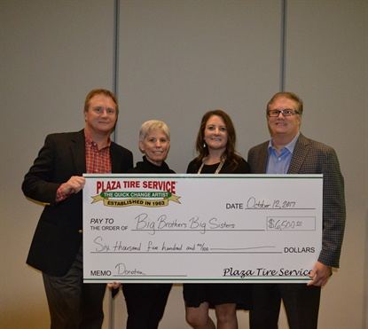 Plaza Tire Service gave Big Brothers Big Sisters of Eastern Missouiri $6,500 of its advertising winnings from the 2017 Tire Dealer of the Year Award. From left, Mark Rhodes, Becky Hatter and Ashley Beggs Seiler of Big Brothers Big Sisters, and Scott Rhodes.