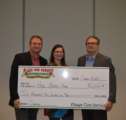 Mark Rhodes, left, and Scott Rhodes, presented $6,500 to Crissy Mayberry of Hope Children's Home.