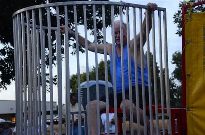 Ricky Benton, MTD's 2015 Tire Dealer of the Year, took a turn in the dunking booth at the 2015 Black's Tire Family Day, which was attended by 1,400 people.