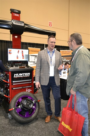 Pat Horn from Hunter Engineering Corp. talks to Ronny DuPree of DuPree Tire in Lufkin, Texas, during the K&M Tire Dealer Conference trade show.