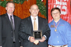 David Duke of National Express Corp. (center) accepted the Hero Award presented to Durham School Services by Dave Breen of Special Olympics Illinois (left) at the organization's annual appreciation dinner. They are pictured with Special Olympics athlete/global messenger Garrett Anderson.