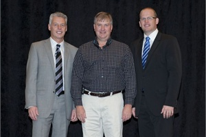 Bruce Ross (center), president of Ross Bus and Equipment Sales, represented the dealership for winning Blue Bird's 2011 Dealer of the Year Award. Ross is pictured with Phil Horlock (left), president and CEO of Blue Bird Corp., and Steve Girardin, president of Micro Bird Inc.