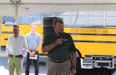 Dean Transportation recently marked 50 years in the pupil transportation industry. Shown here is Kellie Dean, president of Dean Transportation, speaking at a back-to-schooleventhosted by the company in August. Photo courtesy Dean Transportation