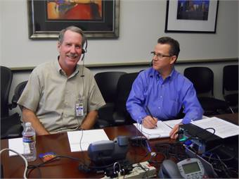 RTD Director Tom Tobiassen, who represents District F, and Dave Genova, RTD Assistant General Manager of Safety, Security and Facilities, host one of RTD's first telephone town hall meetings. Photo courtesy Denver RTD.