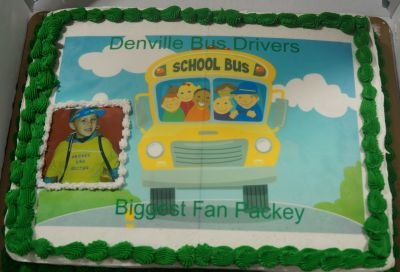 "A cake made for the occasion recognized Packey as the Denville school bus drivers' ""biggest fan."""