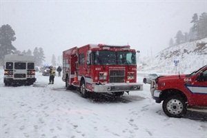 "In a snowstorm near Aspen Park, Colo., the driver of a bus with other bus drivers on board had pulled over to put on snow chains. John ""Jack"" Garland, one of the bus drivers who had gotten out to help, was fatally struck by a pickup truck that lost control. Photo by Inter-Canyon Fire Protection District"