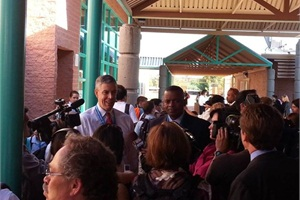 U.S. Education Secretary Arne Duncan (left) and Transportation Secretary Anthony Foxx talk to members of the media after riding a school bus to Dodge Traditional Magnet Middle School in Tucson, Ariz., on Wednesday morning.Photo courtesy the American School Bus Council