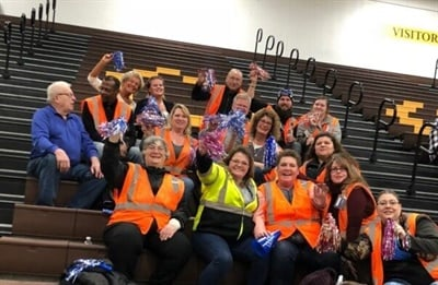 Durham School Services recognized its Carpentersville, Illinois, special-needs transportation team with its Customer Champion Award. They cheered on special-needs students at a basketball game.