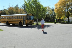 Durham School Services will take over and operate Shelby County (Tenn.) Schools' entire fleet and all of its routes. Pictured is a district bus leaving a middle school in 2012.