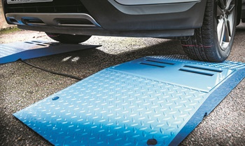 TreadReader Drive Over Ramp uses laser sensors to take measurements of footprints of passenger and light truck tires.